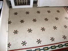 """Hex tile pattern in the front entryway of the the """"endangered"""" Double House at 4018 Ingersoll, Des Moines. Built in 1909."""