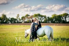 This is my fiance and I during our engagement session with the wonderful Maureen Cassidy! I had to have my horse in it! My fiance is 6'7 so he dwarfs my 15.2hh horse:(