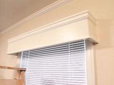 DIY window cornices - These DIY window cornices add polish to any room. You can get them for less money than you think! Learn how to build them yourself for 1/4 the price of store-bought cornices. by ruth