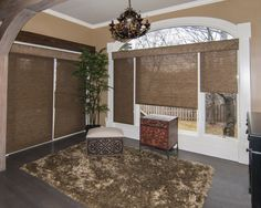 Our dealer Julie Steuber, owner of Jul's Window Decor and More shades this wonderful photo of the work of one of her designers using Horizons Shades of Elegance Roller Shades in the Basket Weave pattern. They are topped with C.O.M. cornices. horizonshades.com