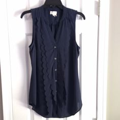 Anthropologie Navy Top/Tunic Size 6 Anthropologie Navy sleeveless top. Size 6. Scallops detail down the whole front as well as buttons. Super fun top for the summer and the winter is easily layered. Anthropologie Tops