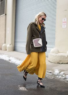 Browse the best street style looks from NYFW Fall 2017 via @STYLECASTER | pleated maxi dress