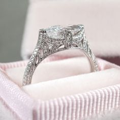 This stunning vintage-inspired engagement ring features a marquise diamond East West set in white gold with bright cut set diamond accents on the tapered shank. Designed and created by Joseph Jewelry | Seattle, WA | Bellevue, WA | Online | Design Your Own Engagement Ring | #engagementring