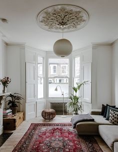 In the white-painted sitting room, a marble fireplace is enlivened with parquet tiling, and wooden floorboards with a Persian rug… Living Room Furnishings, Oak Furniture Living Room, Minimalist Living Room Decor, Living Room Carpet, Living Room Diy, Home Furniture, Living Room Windows, Living Room Designs, Living Room Decor Cozy