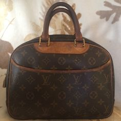 Authentic Louis Vuitton hand bag, well loved. Solid and well loved LV hand bag, gentle signs of wear but clean and shape & structure good. No trades. Louis Vuitton Bags Mini Bags