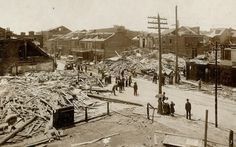 Great Cyclone of 1896 killed 255; The scene at the southwest corner of Seventh and Rutger streets (left foreground), the deadliest spot along the tornado's 10-mile path. Seventeen people were killed when a three-story tenement building collapsed. Frederick Mauchenheimer, who ran a tavern on the ground floor, was playing cards with two patrons when the storm hit. They were among the dead. Across the street, another six died. (Missouri History Museum)