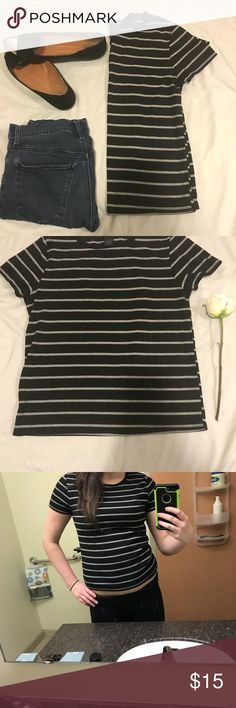 Black & grey stripped t shirt Cute baby doll striped tee by Cheap Monday, size medium. Worn maybe once. Goes great with jeans, leggings, or skirts. You could wear a pair of ripped skinnies and spice it up with a pair of bold heels! Or you can down play it and just lounge around in leggings with it. In excellent condition. 🤗 Questions? Feel free to ask :) from smoke free home. 71% polyester  26% rayon 3% spandex Cheap Monday Tops Tees - Short Sleeve