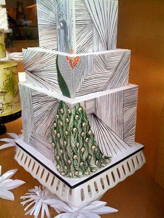 Another cool peacock cake. This one is by I Dream of Cake and features hand-drawn lines on a modern design.