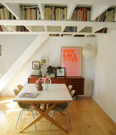 storage | clever out-of-the-way bookshelves by adding planks along the bottom of floor joists
