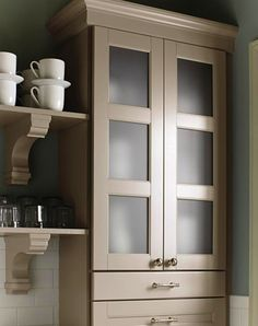 Ox Hill Kitchen: Tall Cabinet Ample storage is necessary in a well-run kitchen. A tall cabinet with mutton doors and frosted glass give you usefulness as well as charm. - -This could be just the thing for next to the stove
