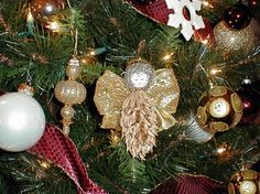 magnolia tree pod angel, A tree pod is sprayed gold and glittered. A wooden head is added and then wired ribbon for wings., A magnolia tree pod made into an angel with a wooden head and wired ribbon for wings, Holiday Project