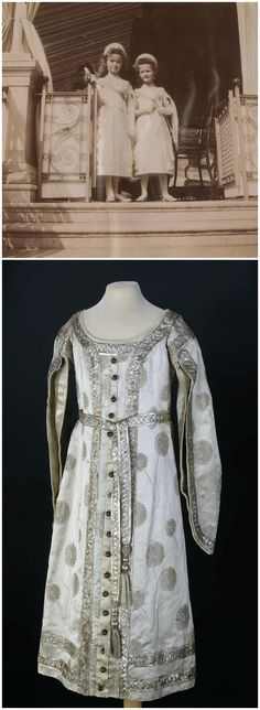 Above: The elder daughters of Tsar Nicholas II, Grand Duchesses Olga Nikolaevna and Tatiana Nikolaevna (left and right, respectively) in their court dresses, 1900s. Photo via Kootyl's Tumblr. Below: Child's court dress, Russia, 1900s. Silk, silver thread, tulle, gaze de soie. State Hermitage Museum, St. Petersburg. The extant gown at the Hermitage is a close match for little Olga's dress, as they are both decorated with a pattern of dandelions. CLICK FOR LARGER IMAGES.