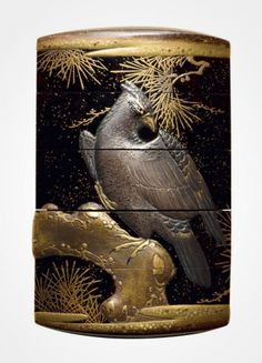 Lacquer inro with hawks perched on pine trees