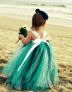 little girl in beautiful turquoise dress on the beach. Can I get this in an adult version?