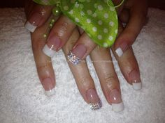 Acrylic nails with French polish and crystals on ring