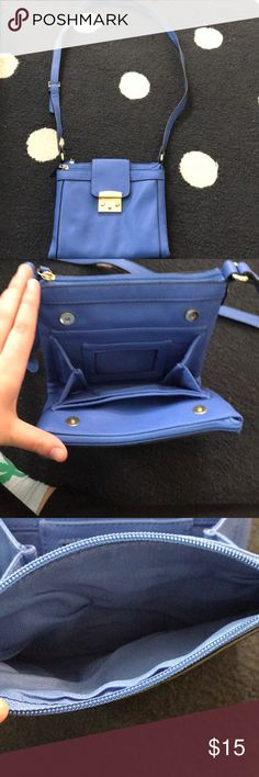 I'm selling a Merona crossbody blue purse!!! Is in pretty good condition. Is blue fox leather. Has a lot of storage!!! Merona Bags Crossbody Bags