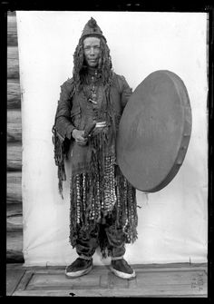 AMNH Image Collection | Yukaghir shaman in ceremonial dress [with drum], Siberia, 1902