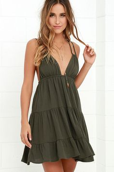 You don't have to look too far for love, because the Somewhere Out There Olive Green Dress is here! Lightweight, gauzy woven rayon sundress has spaghetti straps that support the plunging drawstring bodice, and cross and tie over the open back. Elastic cinches the waist above the tiered skirt.