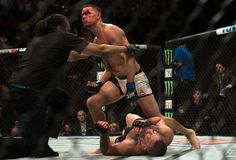 Nate Diaz defeats Conor McGregor via rear naked choke at ufc 196.