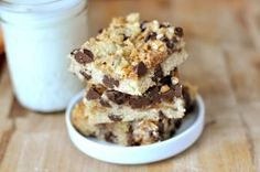 Chocolate Chip Toffee Bars: These are hands down one of my favorite bar desserts to bring to potlucks, BBQ's and the like. A chocolate chip cookie-like crust is topped with sweetened condensed milk, chocolate chips, toffee bits, morsels of the same dough that adorns the crust and is baked until bubbly and golden. | Mel's Kitchen Cafe