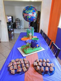 2013 Willy Wonka theme Bday party  using Purple, Green and Orange. Fruity Pebbles treats.