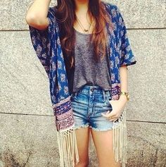 Not exactly, but love the idea of stitching a shawl into a cardigan like this.