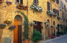 italy tuscany doorways | Italy, Pienza, Tuscany, flowerpots and flowers hung along a wall with ...