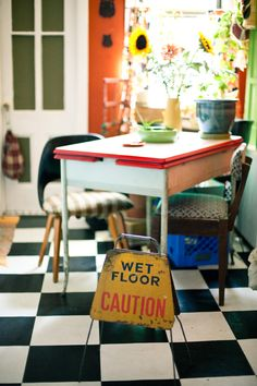 I don't think I'd want the caution sign on my kitchen floor, but I love the checkered floor, the bright colors, the non-matchy-matchy kitchen. White Kitchen Floor, Warm Kitchen, Kitchen Black, Kitchen Dining, Fiesta Kitchen, Vintage Kitchen Accessories, Checkered Floors, Painted Cupboards, Black And White Tiles