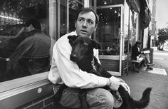Kevin Spacey holds his dog while sitting on bench outside a restaurant.  Photo: Ian Cook, Time Life Pictures/Getty Images