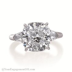 Armadani cushion three stone diamond engagement ring featuring tapered baguettes diamonds