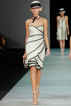 Emporio Armani. Love the dress, shoes, clutch, collar, hat and hair. Work it.