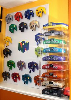 40 Stunning Video Game Controller Storage Design Ideas That You Need To Try - Ah, video game storage: the dilemma of the rising generation. All this new technology, all these new, improved controllers, and not nearly enough floo. Nintendo 64, Super Nintendo, Nintendo Decor, Game Boy, Deco Gamer, Video Game Storage, Video Game Rooms, Video Game Collection, Gamer Room