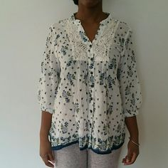 Flower print button up w/ crochet detailing 100% cotton. Purchased in India. Very light weight. Brown buttons. 3/4 sleeves.  Bust 20 inches.  Length 25 inches.  My guess is a size 10 boutique  Tops Button Down Shirts