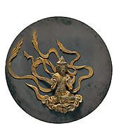 The helmet is shaped like a hat (<i>zukinnari</i>) worn by old men. The ornament at the front is that of the Buddhist guardian figure Fudō Myō-ō.