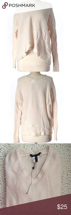 BCBGMAXAZRIA Wool Pullover Sweater Super comfy BCBGMAXAZRIA wool pullover V- neck sweater. Beige color. 80% wool and 20% cashmere. 44% chest and 22% long. Size XXS. Tag fell off but it has never being used. BCBGMaxAzria Sweaters V-Necks