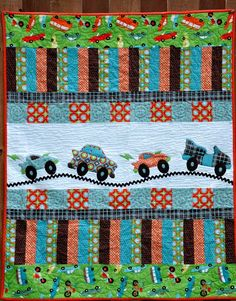 Car quilt. I love the idea of the vehicles going up and down the hills.   Using Rick-rac makes it even more fun.