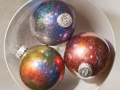 Get A Galaxy Ornament  Clear ornament, add clear floor wax inside, pour in glitter of your choice, shake and enjoy..!