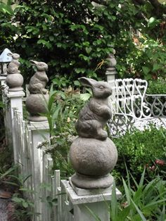 Italian Girl in Georgia: Cottage Garden Inspiration. Love the stone rabbits perched on fence posts.