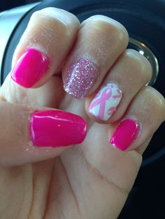 Breast cancer awareness nails Frozen strawberry gel polish Pink diamond glitter nail and an all over ribbon nail! Love it!