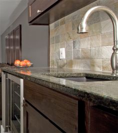 Choosing The Right Countertop For Your Kitchen - check out our blog post here for pros, cons, costs, and eco-friendliness ratings of #granite, #soapstone, #concrete, butcher block, glass, #ceramic, #laminate, wood, stainless steel, #marble, #composite, and #recycled material countertops.
