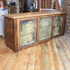 Rustic style reclaimed pine counter, featuring a frontage comprising of three large distressed tin tiles. The unit has an open back with a shelf and drawers. A very distinct piece for that contemporary vintage industrial look, ideal for retail display.