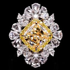 This #WeddingWednesday we have a stunning #engagementring for you featuring a 3.16 carat cushion cut #yellowdiamond with 0.20 carats of…