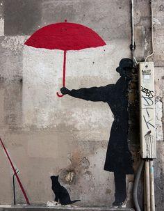 Red Umbrella on rue Saint Merri, Paris by Digirrl
