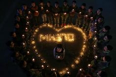 Construction site workers light candles to pray for passengers of the missing flight MH370, in Wuhan, Hubei province in this March 13, 2014 file picture. — Reuters pic