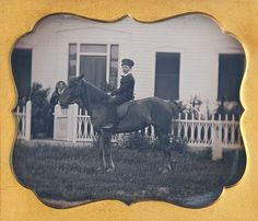 6th plate daguerreotype of a boy seated on his pony, proud mother in the background.