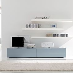 floating shelves, and modern,simple tv unit