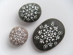 Beautiful hand painted stones from etsy seller artinredwagons.  I could see these in a bowl in the guest bathroom.  You could keep them out all winter!