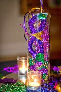 Celebrate Fat Tuesday with stunning Mardi Gras decorations. Check out Mardi Gras DIY Decorations ideas here. These are easy and best Mardi Gras decor ideas. Carnival Centerpieces, Mardi Gras Decorations, Table Centerpieces, Wedding Centerpieces, Masquerade Centerpieces, Feather Centerpieces, Graduation Centerpiece, Quinceanera Centerpieces, Centerpiece Ideas