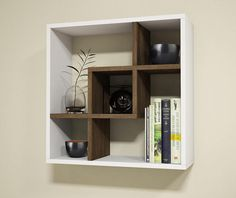 Mercury Row This unique cube shelf will enhance the atmosphere of your living space with its timeless design. It suits both contemporary and classic lifestyles.