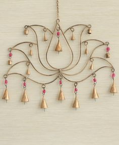 Wall Art from India! A lotus chime made with traditional bells is a wonderful way to add music to your life. Handmade by artisans in India and bedecked with bright pink beads for a splash of color. Suncatchers, Indian Home Decor, Diy Home Decor, Room Decor, Buddha Wall Art, Mobiles, Pooja Room Design, Music Crafts, Diwali Decorations
